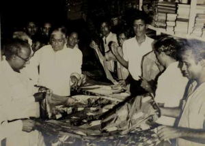 Gajendran(right, foreground) attending to C N Annadurai, former CM of Tamil Nadu(left, foreground)